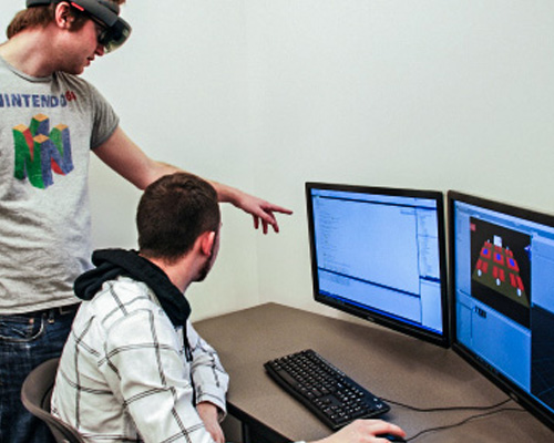 students at a computer testing software