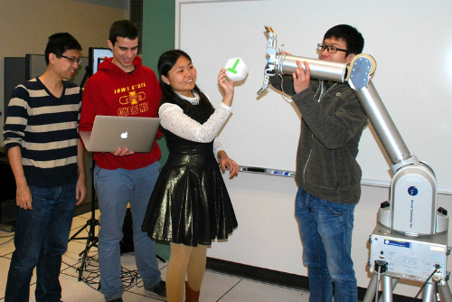 Students working with robotics arms