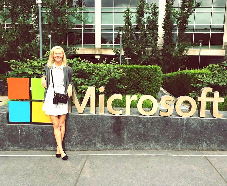 student standing in front of Microsoft building