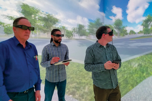 Student and faculty looking at a 3-D rendering