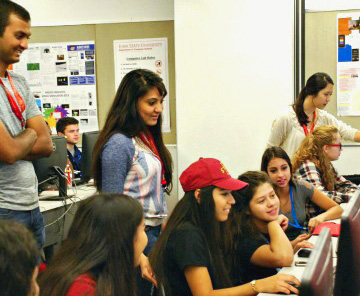 students collaborating in a computer lab