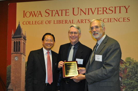Photo of Norm Farrington receiving award