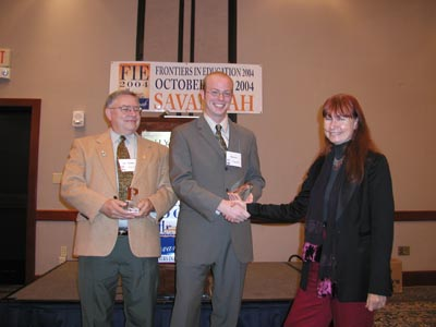 The picture shows Brian Dorn and his collaborator, Dr. Dean Sanders, being presented the award.