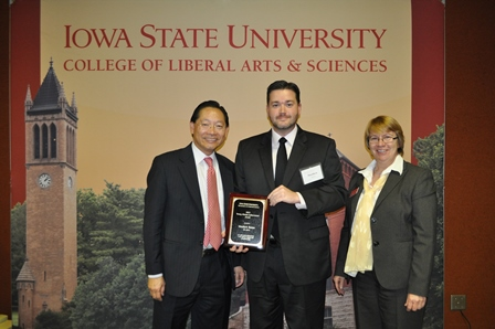 Photo of Matthew Renze receiving award