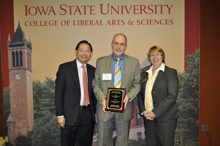 Photo of George Strawn receiving award