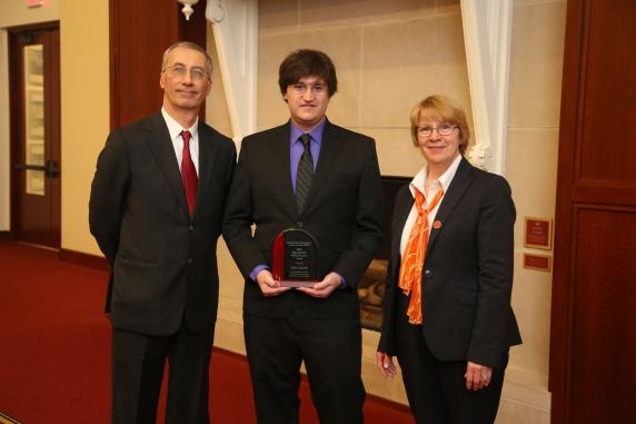 Computer Science Chair, Gianfranco Ciardo at left, with young alumnus award recipient, Sean Stanek in center, receives award from LAS Dean Beate Schmittmann.