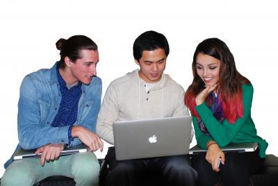 Three computer science students looking at a computer